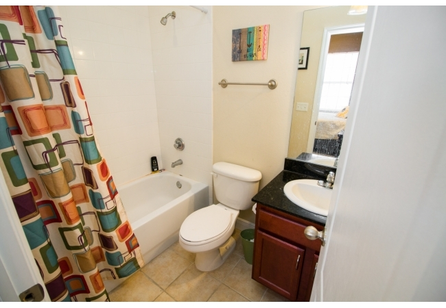 Shower/tubs are tiled and vanities are made from real wood. Granite in the bathrooms is offered in select units.