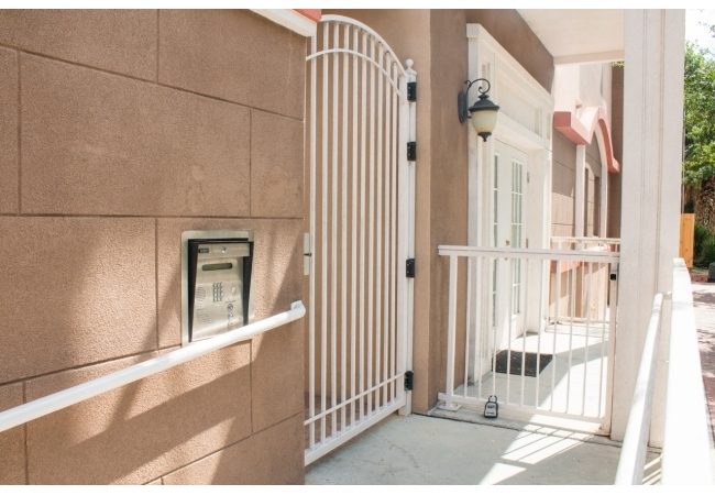 The community features a secure entry system as well as a private garage for residents.
