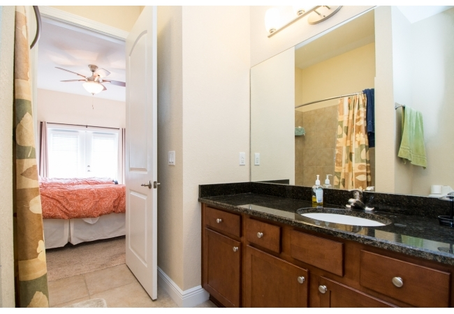 You'll find real-wood vanities with granite and nicely tiled showers with tubs.