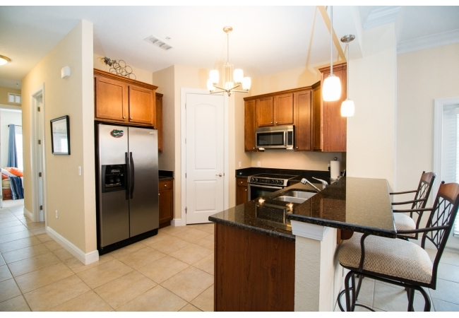 Condos have gourmet kitchens with walk-in pantries and separate laundry rooms.