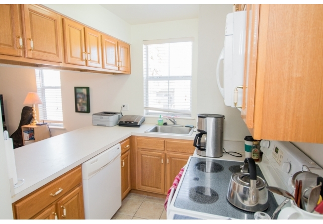 Condos feature kitchens with plenty of cabinetry and a dishwasher.