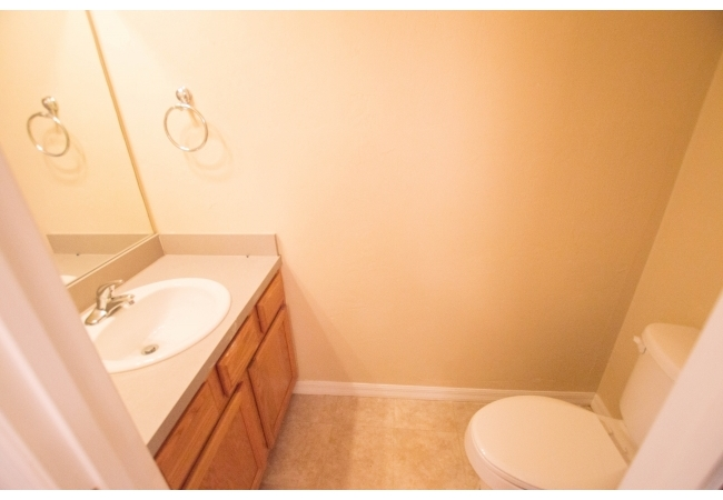 The half bathroom downstairs is convenient for residents and their guests.