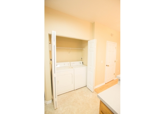 The laundry closet is adjacent to the kitchen.
