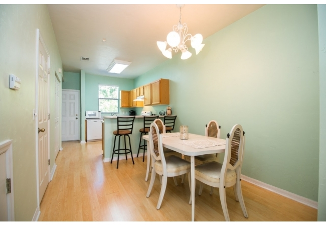 The kitchen and dining area are separated by a convenient elevated breakfast bar.