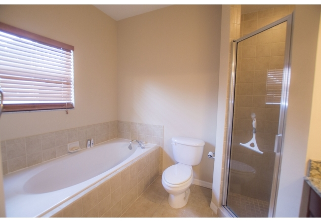 This shower and tub combination within the master bath is a rare feature in Gainesville condos.