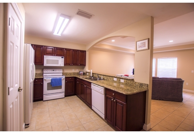Condos feature gorgeous kitchens with granite counter tops and real wooden cabinetry.