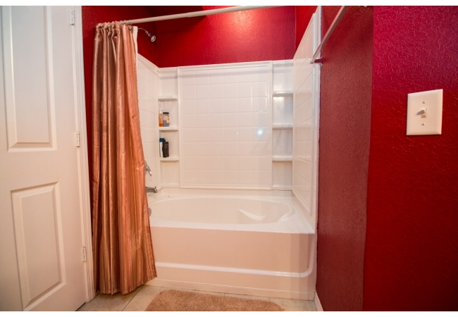 The shower/tubs have built in shelving for extra storage.