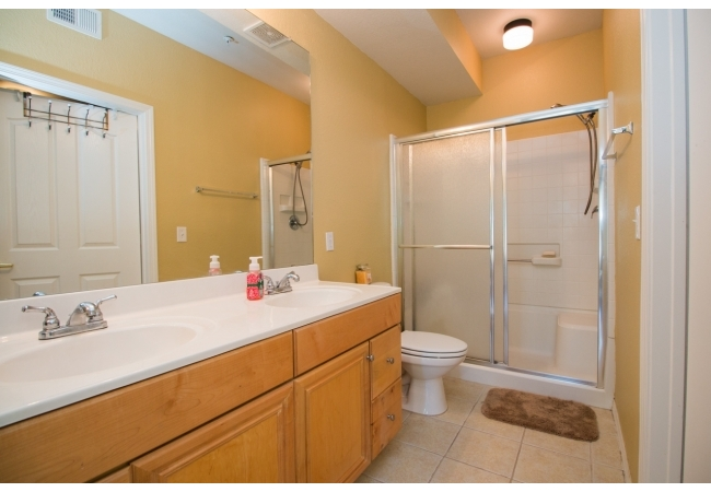 Master bathrooms have dual vanity sinks. In the 3BR plan, the master bedroom has a huge walk-in closet.