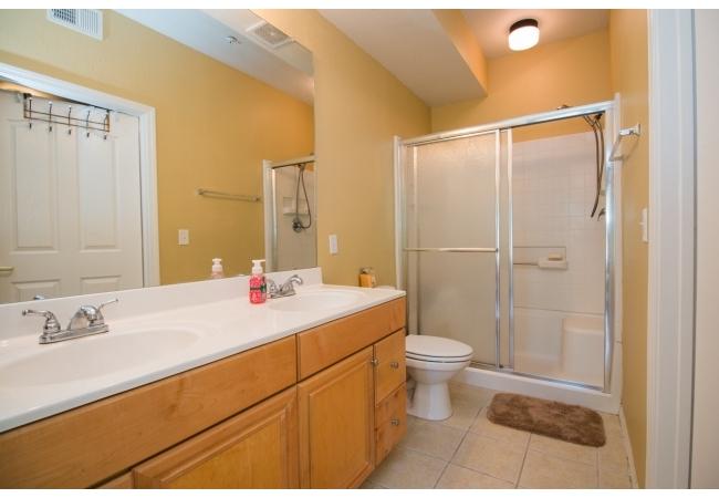 Master bathrooms have dual vanity sinks. In the 3BR plan, the master bedroom has a huge walk-in closet.