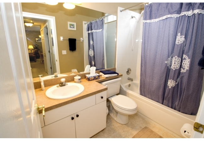 Bathrooms provide space and comfort in these condos.