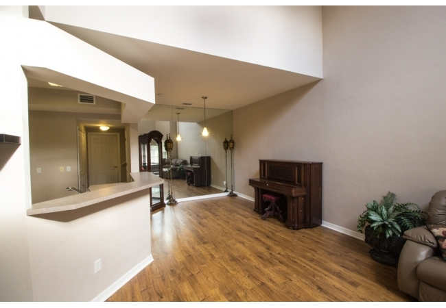 This floor plan is best known for incredibly high ceilings as well as an upstairs den that can be used as an office or 3rd bedroom!