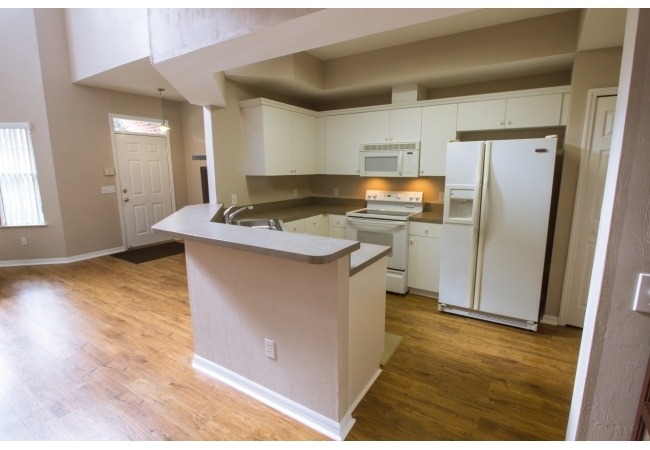 Kitchens are open and even have an elevated breakfast bar. This condo was built for entertaining!