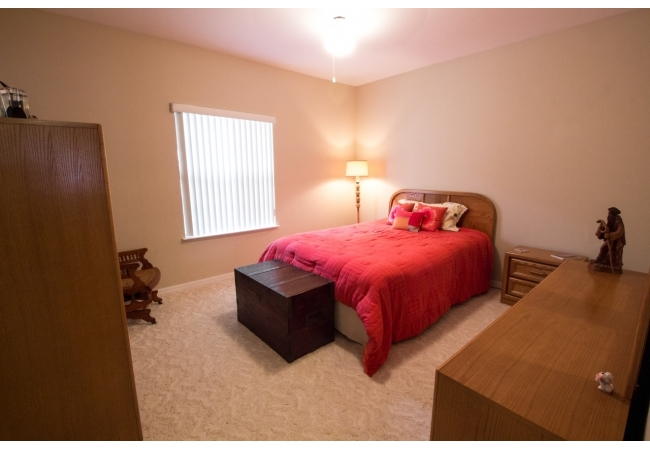 The upstairs and downstairs master bedrooms are large rooms both identical in size.