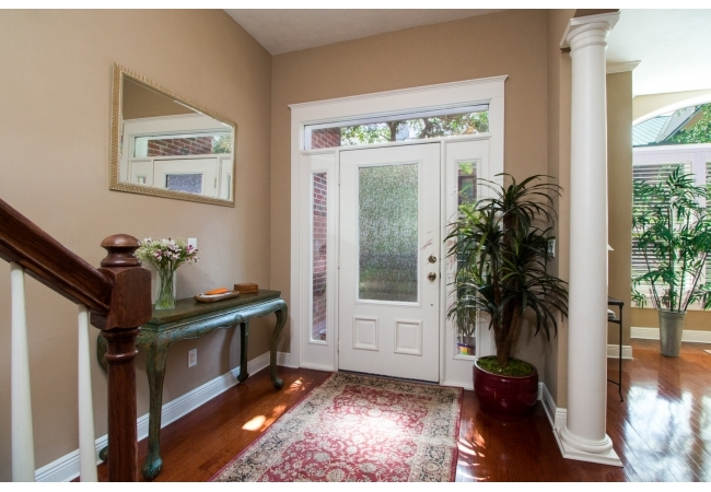 This interior shot of an entryway in a 3 bedroom town home show the intricate building features.