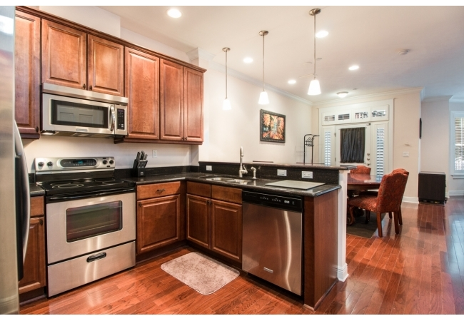 This kitchen has everything a young professional would need all within steps from Downtown.