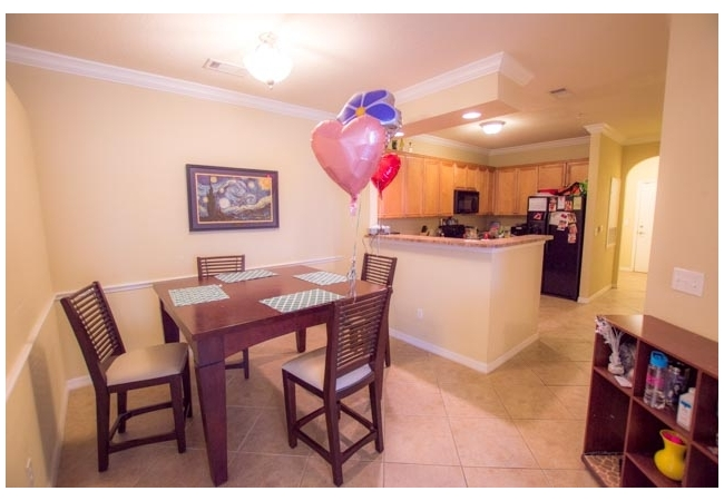 The kitchen overlooks a formal dining area that is perfect for studying!