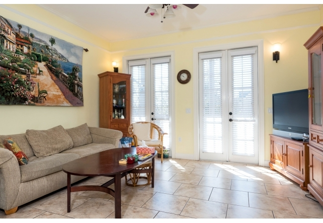Condos feature 11-foot ceilings throughout.