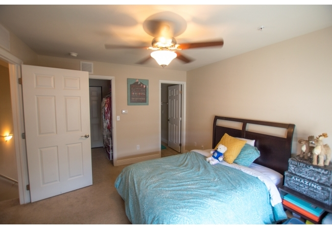 View of the doorways to the closet and bathroom in the upstairs master suite.