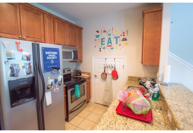 Condos have elegant kitchens with granite counter tops and real-wood cabinetry.
