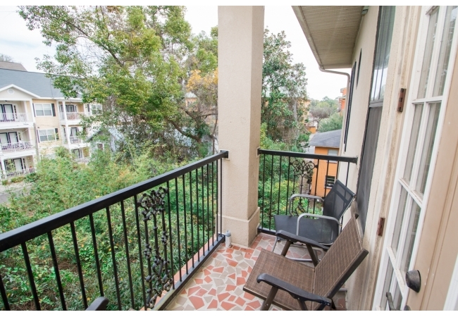 Condos feature balconies with beautiful mosaic tile floors.