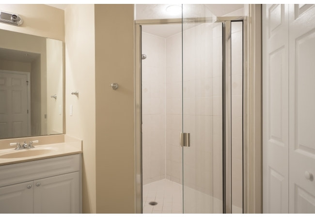 Some bathrooms have nice walk-in showers with glass doors.