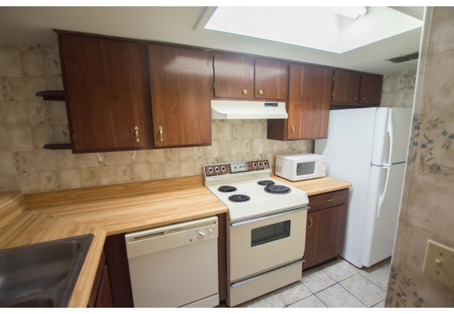 The L-shaped kitchens lead to a large laundry room/pantry.