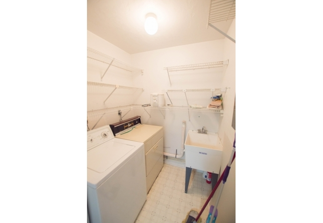 Some condos like this one have a sink basin within the laundry room.