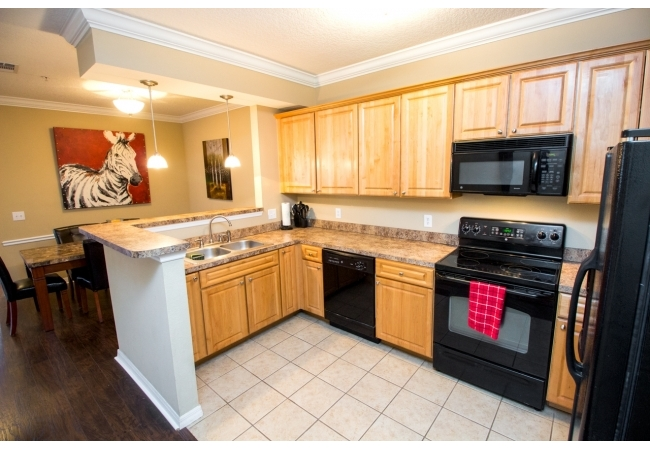 Luxury kitchens are equipped with real wood cabinetry and an elevated breakfast bar.