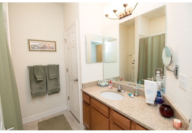 The master bathroom is elegant and spacious with an additional storage closet.