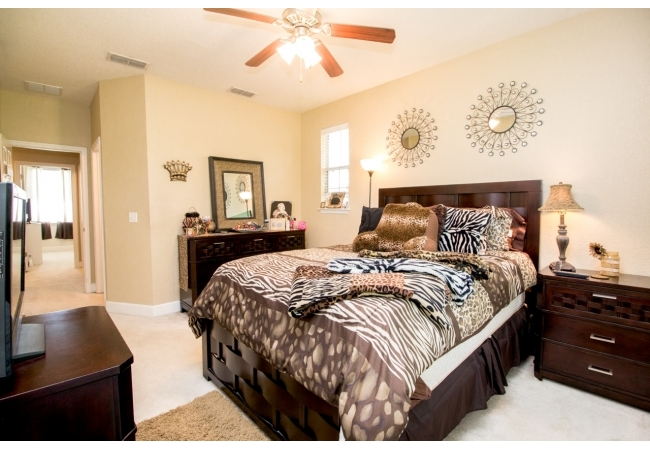 Large bedrooms with high ceilings create the allure of luxury.