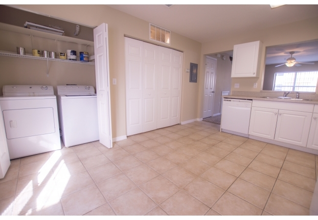 Just off the kitchen, conveniently located, is a laundry closet and additional storage closet.