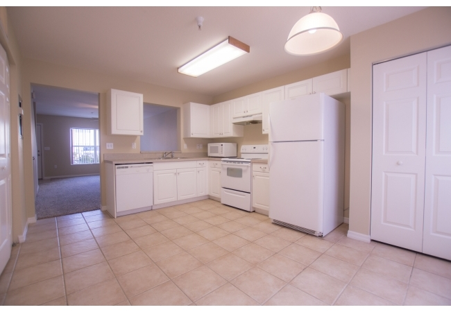 This floor plan dedicates more square footage to the kitchen area than most condos of similar size in the area.