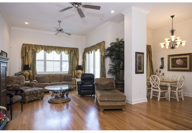 Condos have a large formal living area with very high ceilings.
