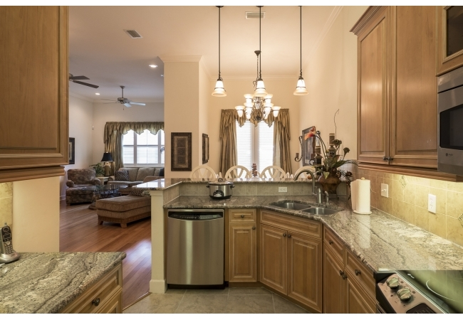 Units have premium appliances with real wood cabinetry and under-cabinet lighting!