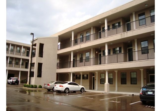Residents enter condos in the back right after parking in the on-site community parking lot.